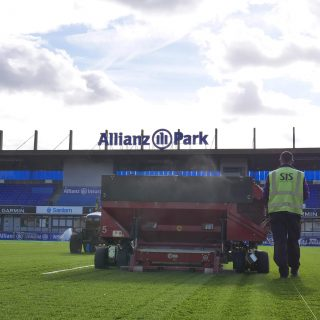 Brushing artificial pitch, synthetic turf installation, grass, hybrid, sand layer