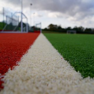 red turf, white lines, grass manufacturer, grass factory, synthetic, artificial, sports grass, sports turf production, sports turf manufacturing