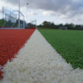 red pitch, white lines, green grass, SISTurf Hockey SISTurf, synthetic, pitch, sand dressed, fields,