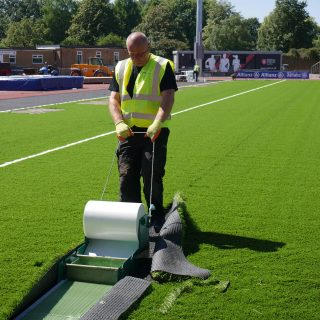 tape edges, Brushing artificial pitch, synthetic turf installation, grass, hybrid
